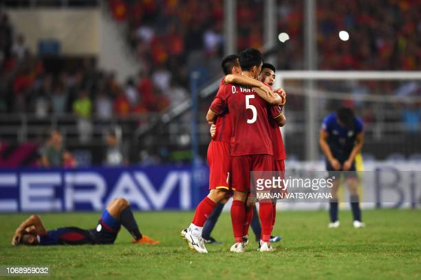 Vietnam's players celebrate at the end of the second leg of the AFF Suzuki Cup 2018 semifinal football match between Vietnam and the Philippines at...