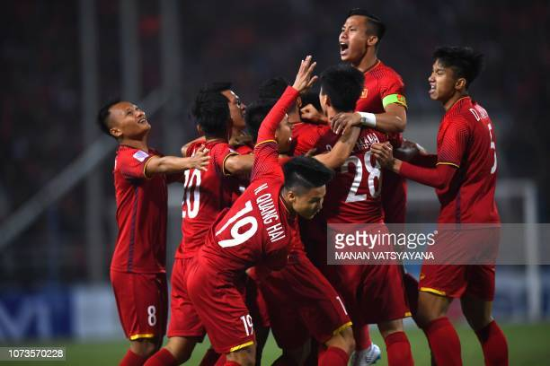 Vietnam's players celebrate scoring the first goal during the AFF Suzuki Cup 2018 final football match between Vietnam and Malaysia at the My Dinh...