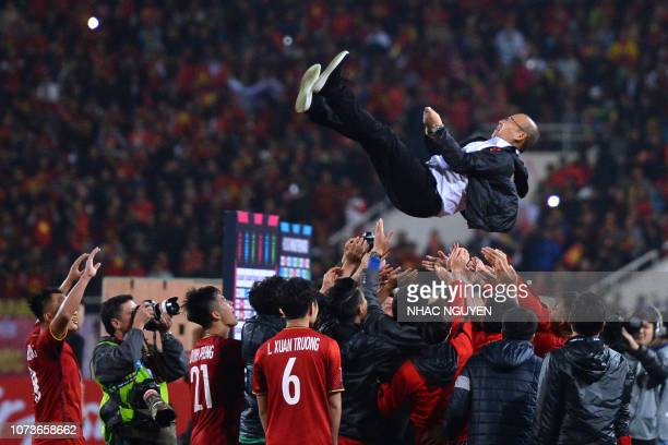 Vietnam's players celebrate with coach Park Hang-seo after winning the AFF Suzuki Cup 2018 championship following the AFF Suzuki Cup 2018 final...