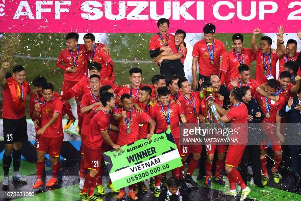 Vietnam's players celebrate with the trophy after winning the AFF Suzuki Cup 2018 championship following the AFF Suzuki Cup 2018 final football match...