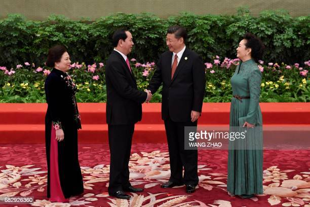 Vietnam's President Tran Dai Quang and his wife Nguyen Thi Hien meet Chinese President Xi Jinping and his wife Peng Liyuan during a welcome ceremony...