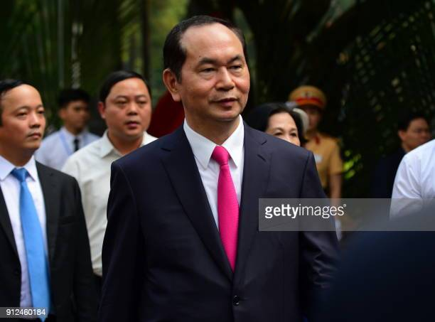 Vietnam's President Tran Dai Quang arrives to attend a ceremony marking the 50th anniversary of the Tet Offensive in Ho Chi Minh City on January 31...