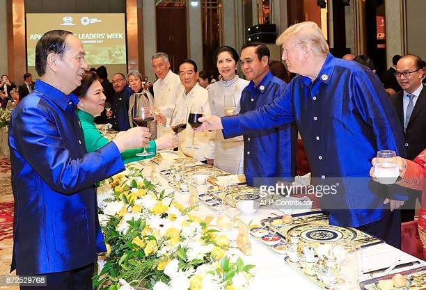 Vietnams President Tran Dai Quang makes a toast with US President Donald Trump at the start of the AsiaPacific Economic Cooperation Summit leaders...