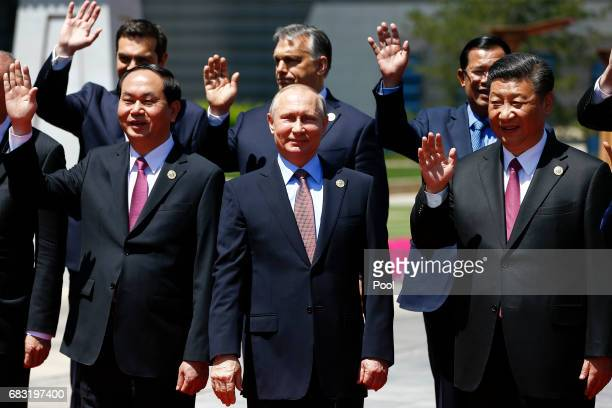 Vietnam's President Tran Dai Quang Russian President Vladimir Putin Chinese President Xi Jinping and other delegation heads pose for a group photo as...