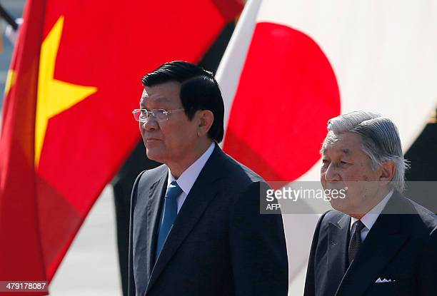 Vietnam's President Truong Tan Sang and Japan's Emperor Akihito attend a welcoming ceremony at the Imperial Palace in Tokyo on March 17 2014 Sang is...