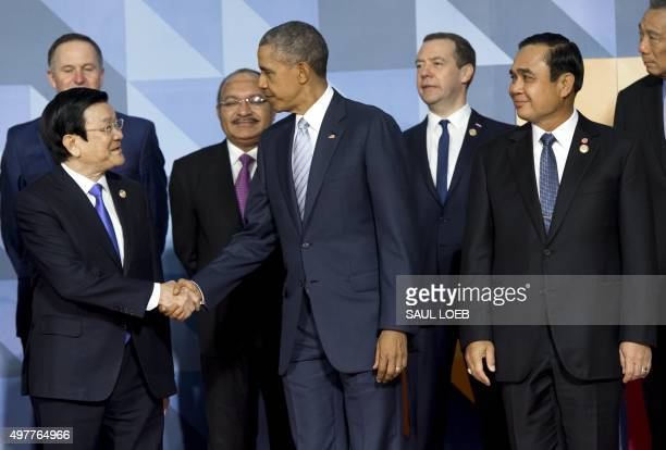 Vietnam's President Truong Tan Sang shakes hands with US President Barack Obama alongside Thailand's Prime Minister Prayut Chan-O-Cha as they pose...