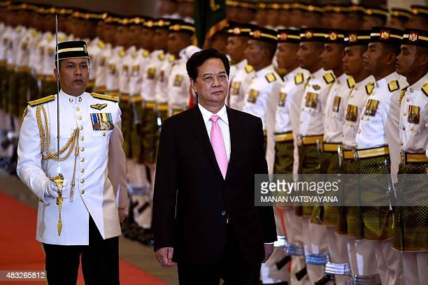 Vietnam's Prime Minister Nguyen Tan Dung inspects a ceremonial guard of honour during a welcoming ceremony at the Malaysian prime minister's office...