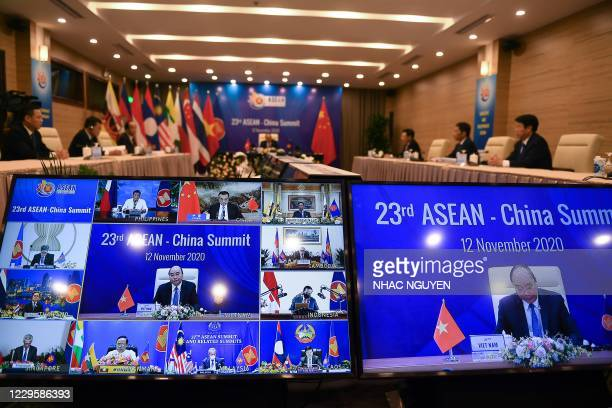 Vietnam's Prime Minister Nguyen Xuan Phuc addresses counterparts at the ASEAN-China summit of the Association of Southeast Asian Nations , held...