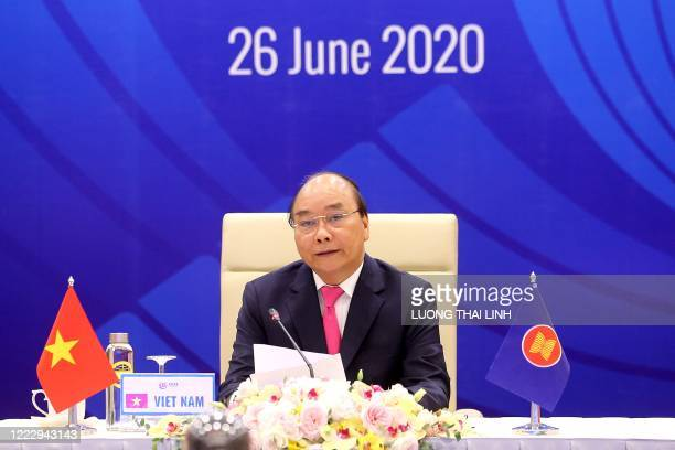 Vietnam's Prime Minister Nguyen Xuan Phuc addresses regional leaders during the Association of Southeast Asian Nations Summit, held online due to the...