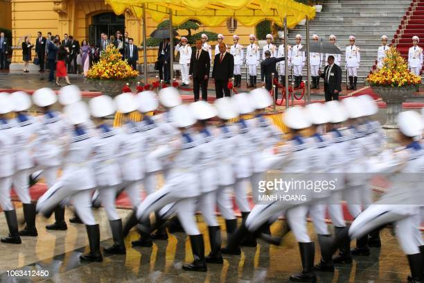 TOPSHOT Vietnam's Prime Minister Nguyen Xuan Phuc and his Russia's counterpart Dmitry Medvedev review an honor guard during a welcoming ceremony at...