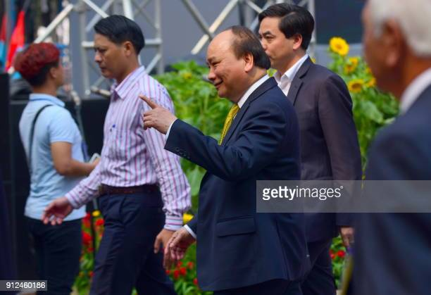 Vietnam's Prime Minister Nguyen Xuan Phuc arrives to attend a ceremony marking the 50th anniversary of the Tet Offensive in Ho Chi Minh City on...