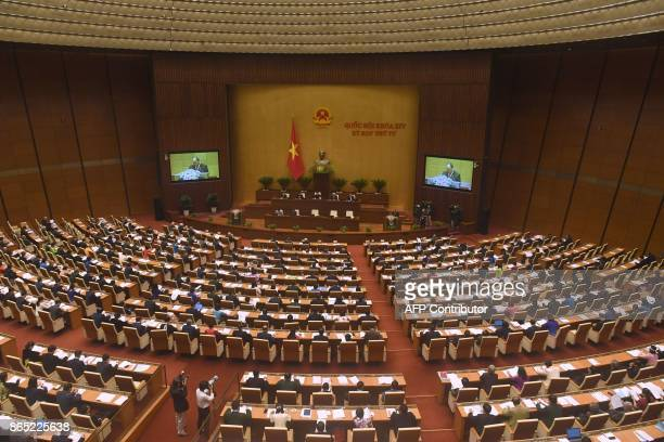 Vietnam's Prime Minister Nguyen Xuan Phuc delivers the main socioeconomic report at the second annual session of the National Assembly in Hanoi on...