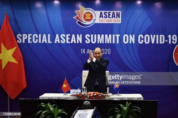 Vietnams Prime Minister Nguyen Xuan Phuc greets other member country leaders during a live video conference on the special Association of Southeast...