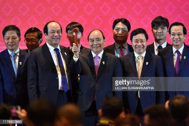 Vietnam's Prime Minister Nguyen Xuan Phuc holds the gavel for ASEAN chairmanship in 2020 during the closing ceremony of the 35th Association of...