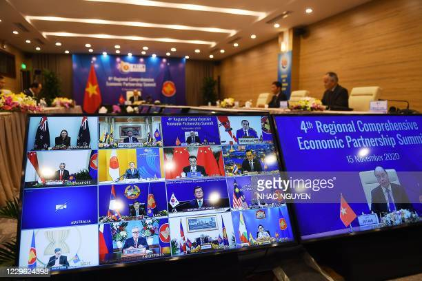 Vietnam's Prime Minister Nguyen Xuan Phuc is pictured on the screen as he addresses his counterparts during the 4th Regional Comprehensive Economic...