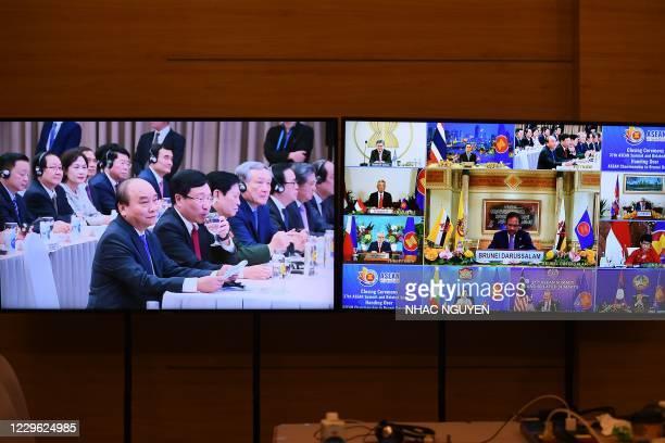Vietnam's Prime Minister Nguyen Xuan Phuc looks on as the next Association of Southeast Asian Nations summit host Brunei's Sultan Hassanal Bolkiah ,...