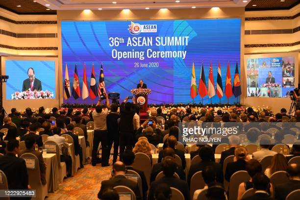 Vietnam's Prime Minister Nguyen Xuan Phuc speaks during the opening ceremony of the Association of Southeast Asian Nations Summit, held online due to...