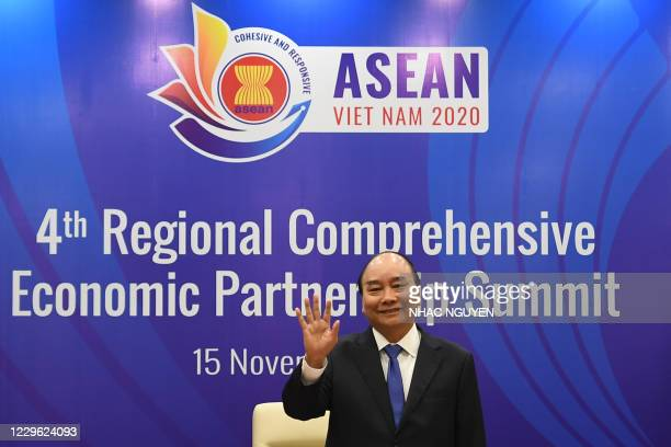 Vietnam's Prime Minister Nguyen Xuan Phuc waves during the 4th Regional Comprehensive Economic Partnership Summit at the Association of Southeast...