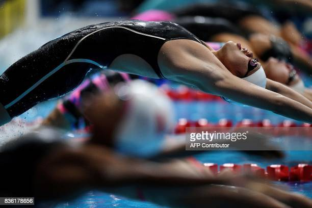 Vietnam's Thi Anh Vien Nguyen competes in the women's 100m backstroke swimming final of the 29th Southeast Asian Games at the National Aquatics...