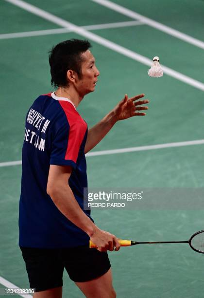 Vietnam's Thuy Linh Nguyen prepares between points with Azerbaijan's Ade Resky Dwicahyo in their men's singles badminton group stage match during the...