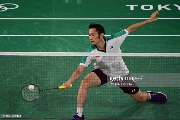 Vietnam's Tien Minh Nguyen hits a shot to Denmark's Anders Antonsen in their men's singles badminton group stage match during the Tokyo 2020 Olympic...