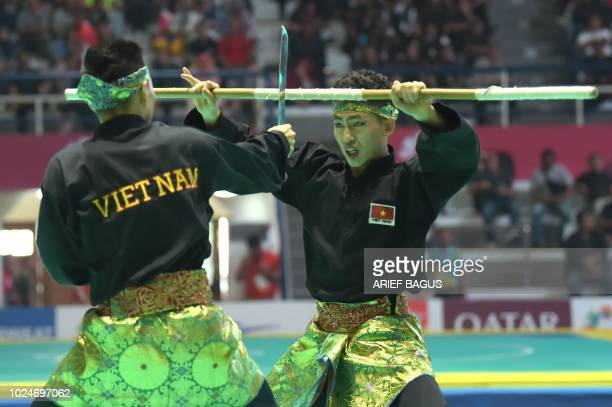 Vietnam's Tran Duc Danh and Le Hong Quan perform in the men's doubles seni event at the pencak silat competition at the 2018 Asian Games in Jakarta...