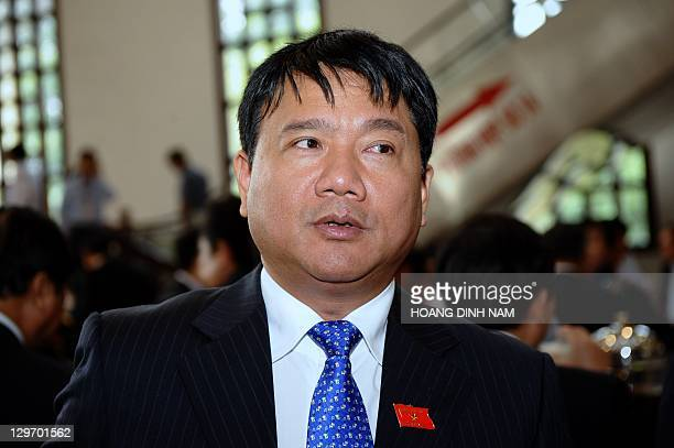 Vietnam's Transport Minister Dinh La Thang arrives to attend the opening ceremony of the second annual session of the National Assembly in Hanoi on...