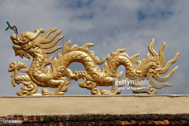 vietnamse dragon on pagoda - china east asia stock pictures, royalty-free photos & images