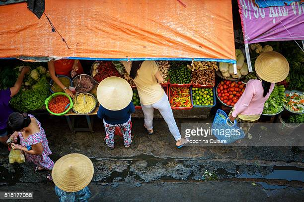vietnamsese non la (vietnamese conical hat) in market of saigon, vietnam - traditionally vietnamese stock pictures, royalty-free photos & images