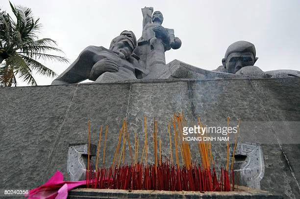 Vietnam-war-US-anniversary by Aude Genet Incense sticks are placed at the monument to the massacre victims at the site of the My Lai massacre museum...