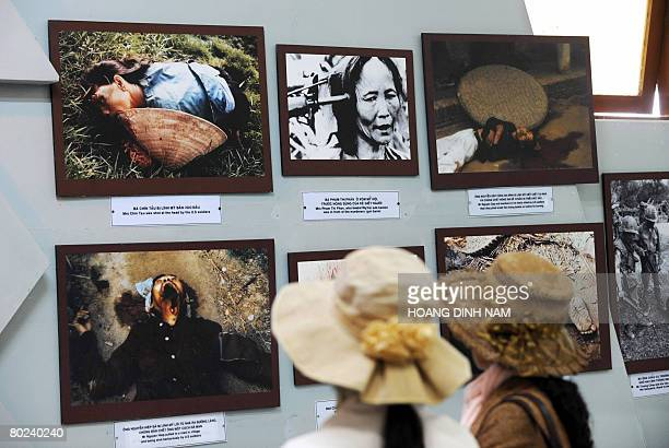 Vietnam-war-US-anniversary by Aude Genet Two young women look at photographs showing massacre scenes as they tour the My Lai massacre museum at My...