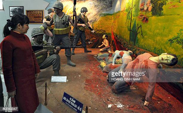 VietnamwarUSanniversary by Aude Genet Visitors look at a recreated scene at the massacre museum at My Lai village in the central province of Quang...
