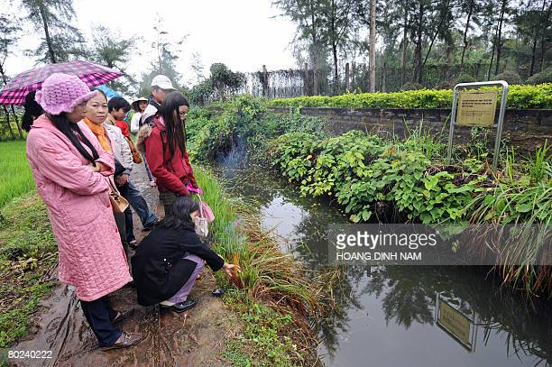 VietnamwarUSanniversary by Aude Genet Visitors pay hommage with incense sticks at a canal where some 170 villagers were captured and shot dead during...