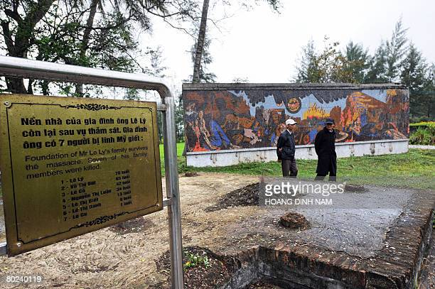 Vietnam-war-US-anniversary by Aude Genet Visitors walk past what is recreated as the foundation of a home destroyed by US soldiers during the...
