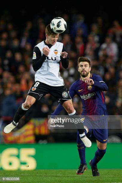 Vietto of Valencia CF heads the ball next to Gerard Pique of FC Barcelona during the Copa del Rey semifinal second leg match between Valencia CF and...