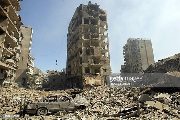 View 14 August 2006 of the rubble of buildings hit in Israeli strikes in the Hezbollah stronghold of Beirut southern suburb A UNbrokered ceasefire...