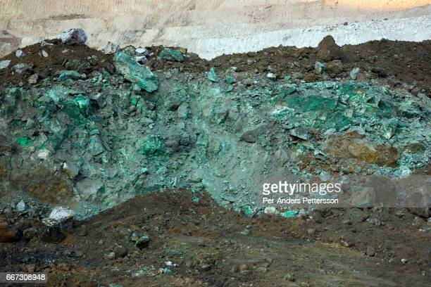 A view a copper rich rock as the sun sets in one of the open pit copper mines at Mutanda Mining on July 7 2016 in Kolwezi DRC Sarl owned by Glencore...