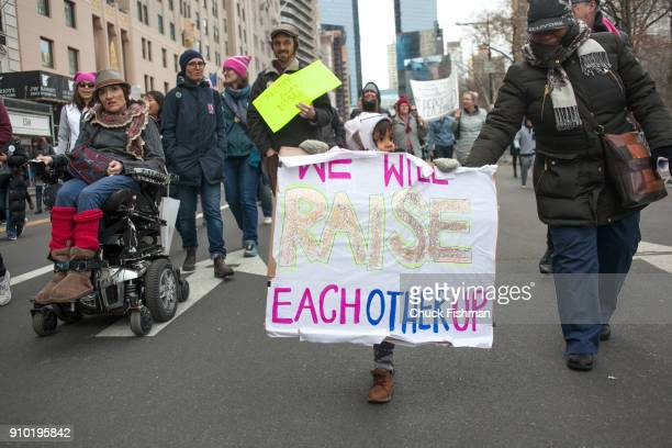 View a young demonstrator on Central Park South during the Women's March on New York New York New York January 20 2018 She holds a sign that reads...