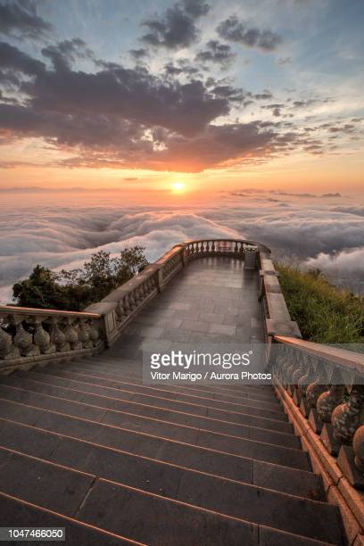 view above clouds at corcovado mountain, rio de janeiro, brazil - corcovado stock pictures, royalty-free photos & images