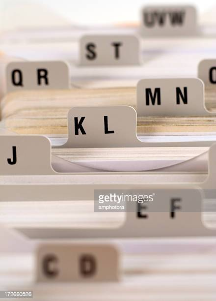 View above index cards with two letters on each card