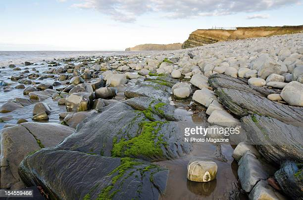 View across a boulder beach down the south west coast of England taken on March 19 2012