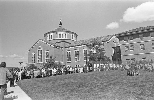 View across a lawn of the crowd gathered outside the Shrine Chapel at Saint Joseph's Provincial House to attend a Mass in celebration of Elizabeth...