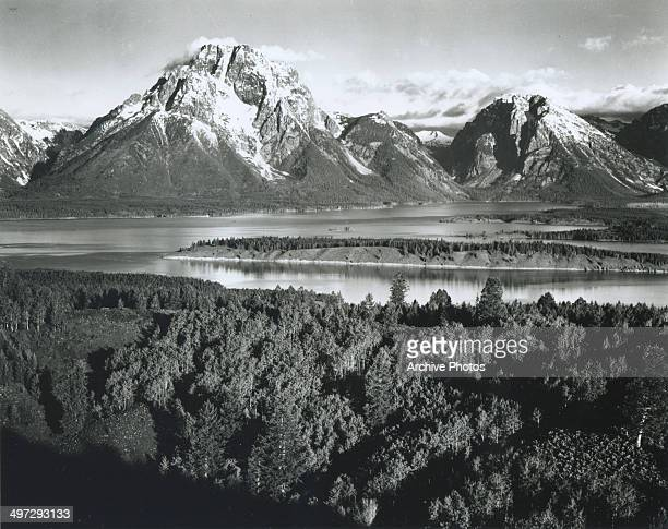 View across a river valley towards Mount Moran in the Teton Range in Grand Teton National Park Wyoming 1941
