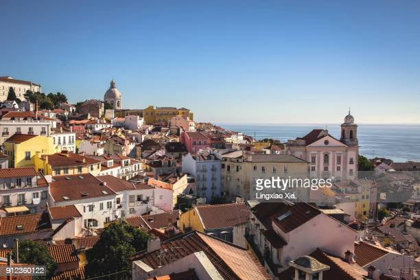 view across alfama neighborhood from miradouro de santa luzia, lisbon, portugal - lisbonne photos et images de collection