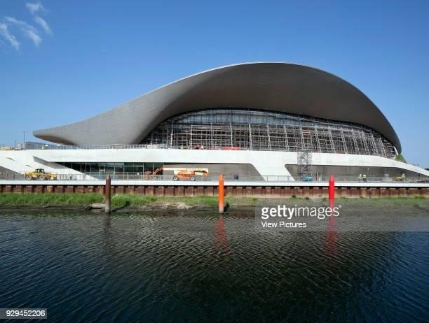 View across canal towards Aquatics center without the extra seating stands London 2012 Aquatics Centre Stratford United Kingdom Architect Zaha Hadid...