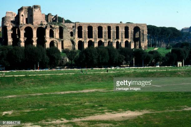 View across Circus Maximus to Palatine Hill Rome c20th century The Circus Maximus is an ancient Roman chariot racing stadium and mass entertainment...