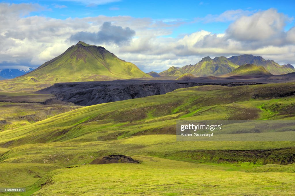 View across grassy and mossy green open land to mountain Hattafell : Stock-Foto