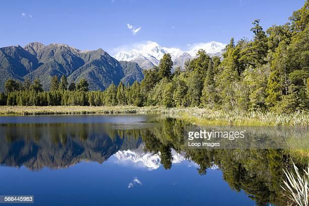 A view across Lake Matheson toward the Southern Alps
