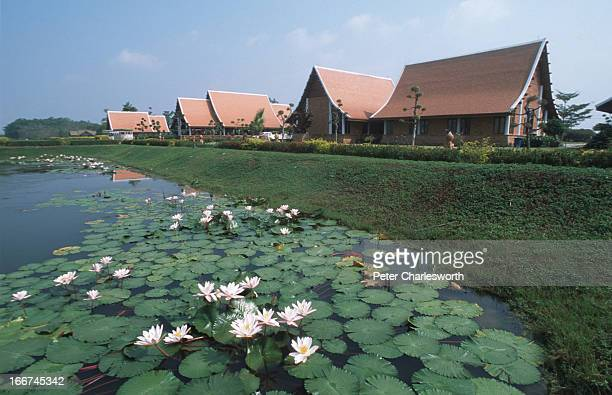 A view across lily ponds in a pond in front of the Sukhothai Airport The airport has won awards and accolades for its Thaistyle architecture