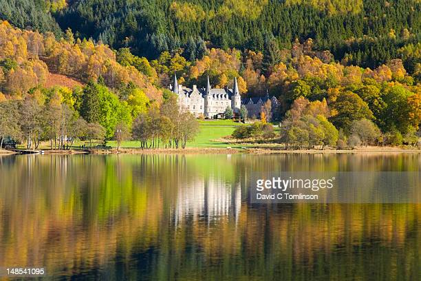 View across Loch Achray to Tigh Mor, former Trossachs Hotel, now holiday timeshare property in autumn.